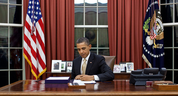 President Obama signing The Middle Class Tax Relief and Job Creation Act of 2012, which authorized the giveaway to TV broadcast licensees under the guise of funding middle class tax relief.